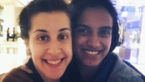 File photo of Carolina Marin and PV Sindhu who will be playing the Badminton World Championships final on Sunday.