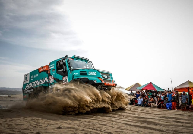 Spectators fascinated by just the massive size of the DAKAR Iveco Camion.