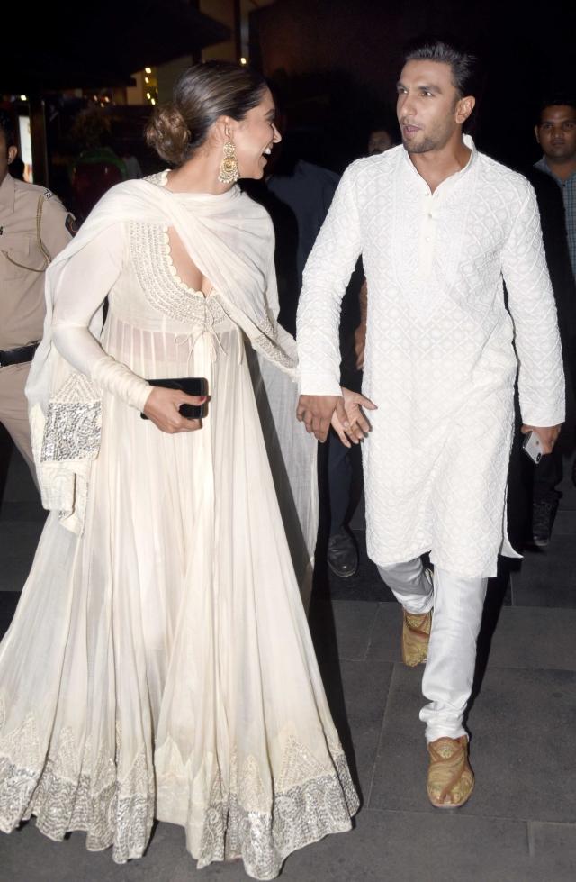 Deepika looks delighted as Ranveer looks on.