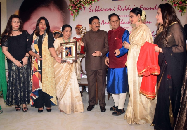 Asha Bhosle is presented with the Yash Chopra Memorial Award.