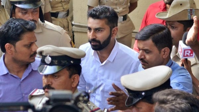 Youth Congress General Secretary Mohammed Haris Nalapad being taken away by police for allegedly assaulting a person in Bengaluru on Monday.