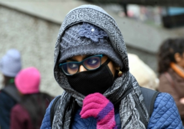 Woman wearing mask. (File Photo: IANS)