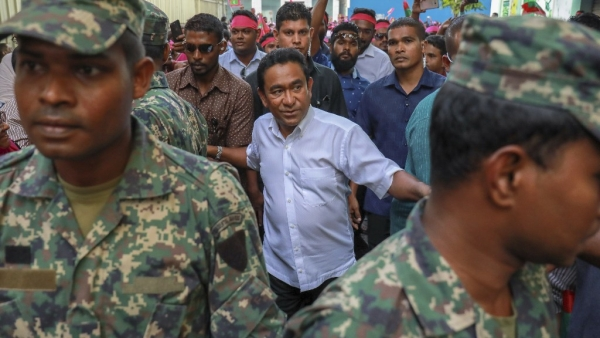 Maldivian President Yameen Abdul Gayoom, centre, surrounded by his bodyguards arrives to address his supporters in Male, Maldives, on 3 February.