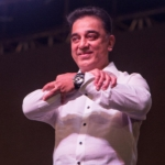 Kamal Haasan forming the symbol of his new party with his hands.