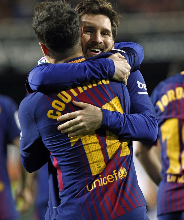FC Barcelona's Coutinho is congratulated by teammate FC Barcelona's Lionel Messi after scoring a goal against Valencia during the Spanish Copa del Rey, semifinal, second leg, soccer match between FC Barcelona and Valencia at the Mestalla stadium in Valencia, Spain, Thursday Feb. 8, 2018.