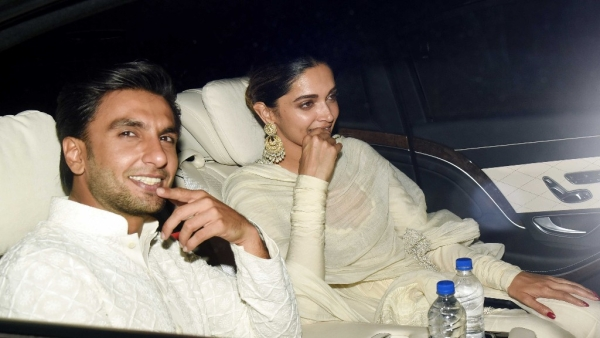 Ranveer Singh and Deepika Padukone arrive together at a screening of <i>Padmaavat</i>.