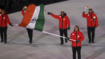 Shiva Keshavan carries the flag of India during the opening ceremony of the 2018 Winter Olympics in Pyeongchang in South Korea.