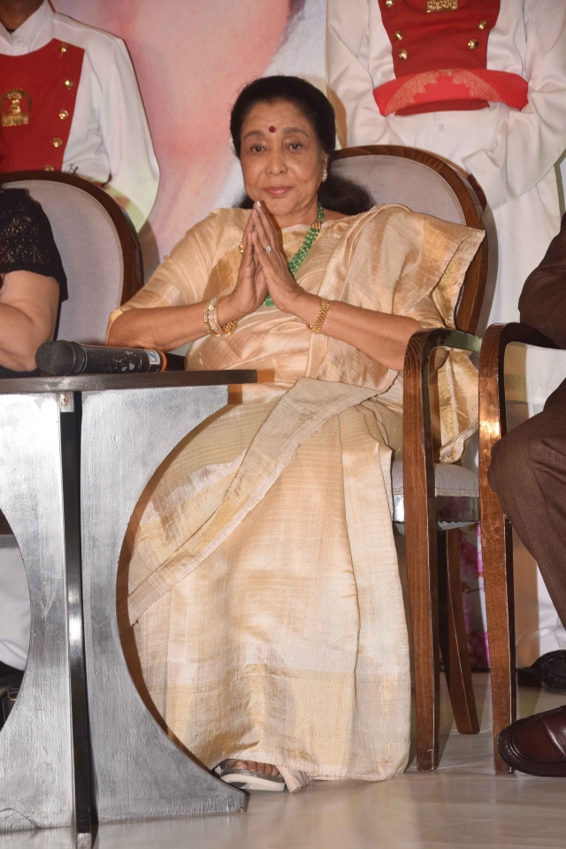 It's an emotional moment for Asha Bhosle.