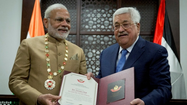 Palestinian President Mahmoud Abbas confers PM Narendra Modi with the 'Grand Collar of the State of Palestine', the highest Palestinian honour for foreign dignitaries.