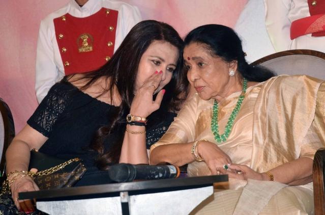 Poonam and Asha deep in conversation.