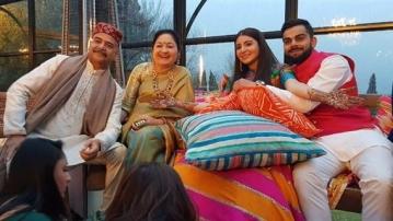 Anushka Sharma's parents with Virat Kohli.