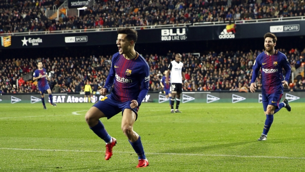 FC Barcelona's Coutinho celebrates after scoring against  Valencia during the Spanish Copa del Rey, semifinal, second leg, soccer match between FC Barcelona and Valencia at the Mestalla stadium in Valencia, Spain, Thursday Feb. 8, 2018.