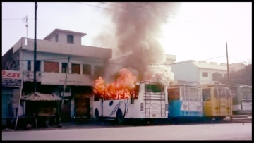 A bus set on fire by an irate mob as two communities clashed in the Kasganj district of Uttar Pradesh on 26 January 2018.