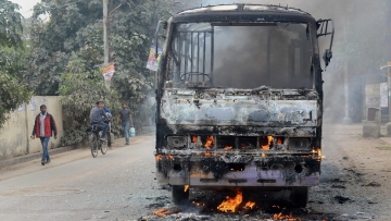 A  city bus that was set ablaze by angry students of the Allahabad Central University while protesting the brutal murder of a law student in Allahabad on Monday, 12 February.
