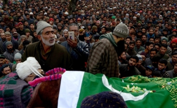 Shopian: People participate in the funeral procession of a 19-year-old Rayees Ahmad who was injured in security force firing in Shopian district succumbed to injuries at Sher-e-Kashmir Institute of Medical Sciences (SKIMS); at Narpora village of Shopian district on Jan 31, 2018. (Photo: IANS)