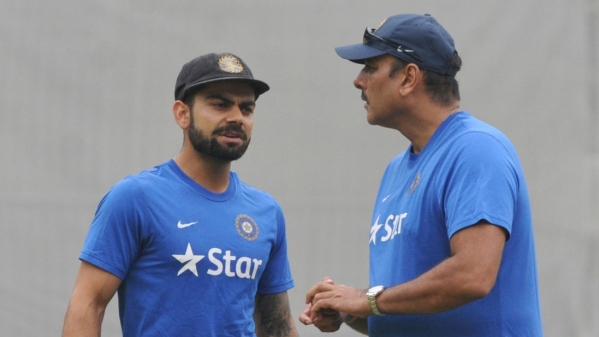 Virat Kohli and Ravi Shastri attend a practice session.