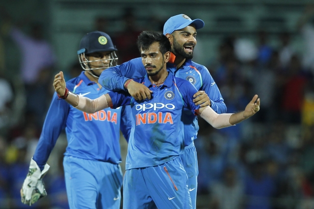 Yuzvendra Chahal of India and Virat Kohli captain of India celebrate the wicket of Glenn Maxwell of Australia during the 1st One Day International between India and Australia held at the M. A. Chidambaram Stadium in Chennai on the 17th September 2017