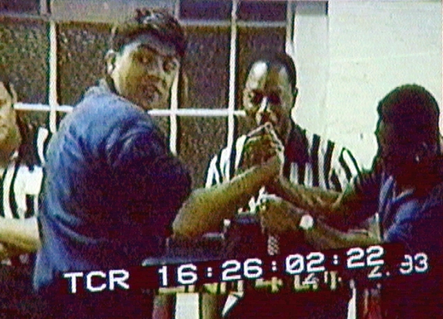A 1993 video grab of Omar in a hand-wrestling bout, a sport he excelled in.