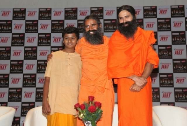 New Delhi: Yoga Guru Baba Ramdev with actor Kranti Prakash Jha and child artiste Naman Jain during a press conference on the launch of a biopic series