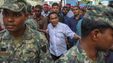 Maldivian President Abdulla Yameen, centre, surrounded by his bodyguards in Male, Maldives.