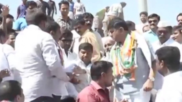 Karnataka Energy Minister DK Shivakumar hits at a man's hand trying to take a selfie with him