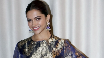 Deepika Padukone looks stunning at an event marking the success of <i>Padmaavat.</i>