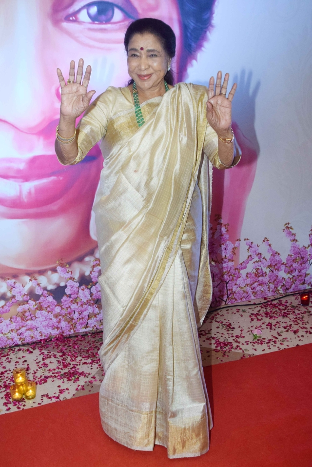 Asha Bhosle greets fans and the media.