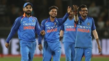 Yuzvendra Chahal, Kuldeep Yadav and Virat Kohli celebrate a wicket.