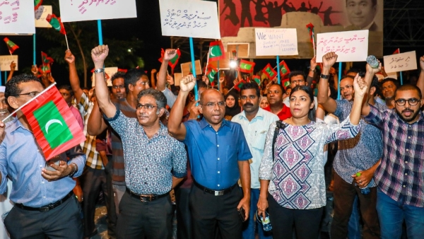 Maldivian opposition supporters shout slogans during a protest as they the urge the government to obey a Supreme Court order to release and retry political prisoners, including an ex-president.