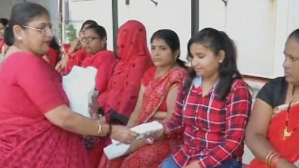 Couple from Surat distributes free sanitary pads to women.