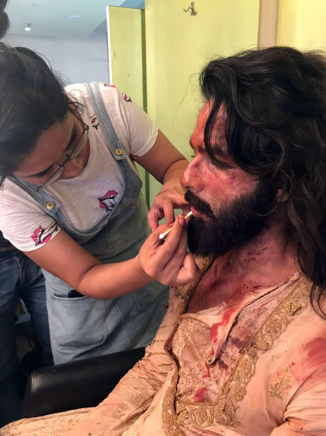 The make-up artist works on Shahid Kapoor's look.