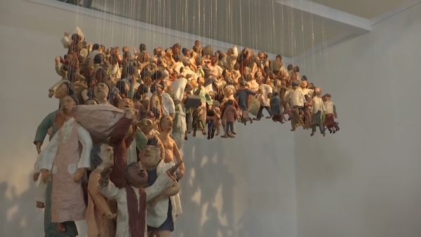 Sculptures hanging by a thread depict the plight of displaced people