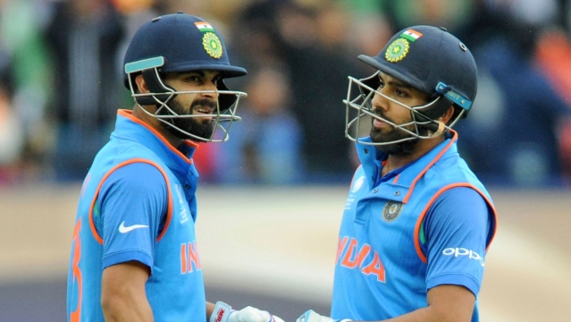 Virat Kohli and Rohit Sharma have a chat during a match.