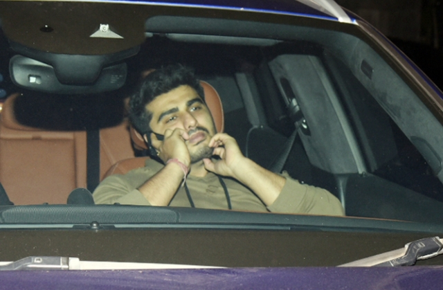Arjun Kapoor is busy chatting as he arrives for the screening.