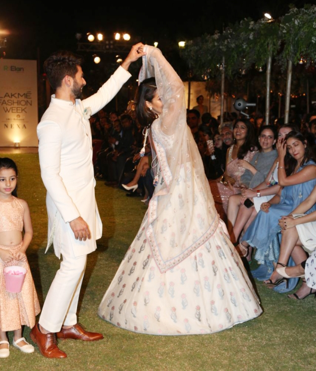 Shahid and Mira do a twirl at the LFW show.