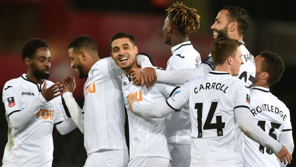 Swansea City's Kyle Naughton celebrates with his team-mates after scoring his side's fifth goal.<a></a>
