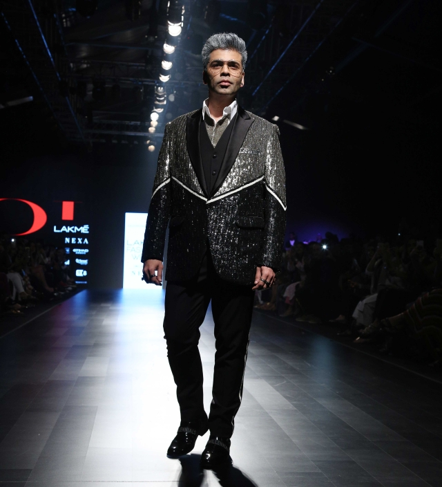 Karan Johar, with his hair streaked silver, rocked the ramp for Falguni & Shane Peacock.
