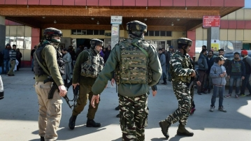 Security personnel stand guard during a search operation after an LeT militant escaped from the police custody with the assailants after Lashkar-e-Taiba militants attacked SMHS hospital, in Srinagar on 6 February.
