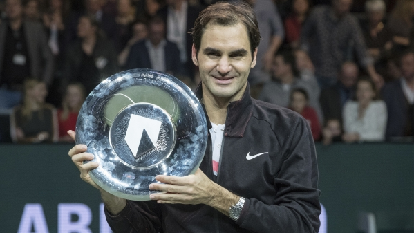 Roger Federer  holds the trophy after winning his match against Bulgaria's Grigor Dimitrov in two sets, 6-2, 6-2, in the men's singles final of the ABN AMRO tournament