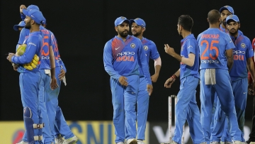 India's Rohit Sharma, center, leads his team after defeating Bangladesh by 17 runs in their second Twenty20 cricket match in Nidahas triangular series in Colombo, Sri Lanka, Wednesday