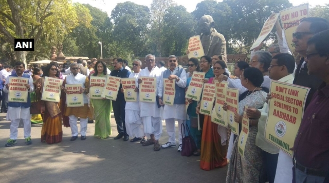 TMC MPs protest in Parliament premises over the issue of Aadhaar linking.
