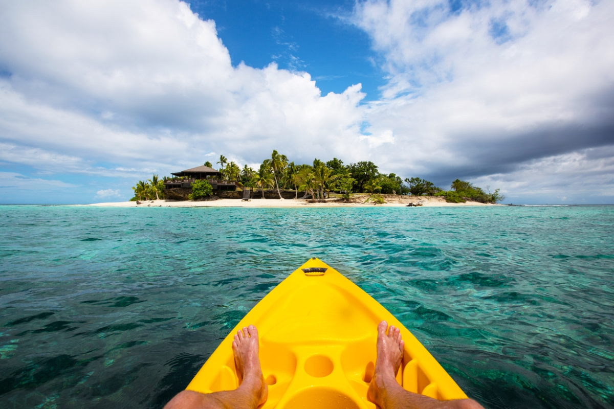 Kayaking by a tropical island in Fiji.