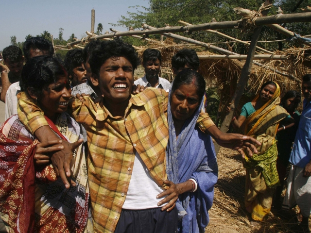 16 March 2007: Soumya Kanti Jana,(C) whose mother Supriya Jana was killed by police on Wednesday, is consoled by relatives in Sonachura, a small village in Nandigram.