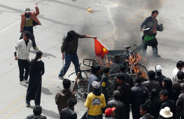 Tibetans burning a Chinese flag in March, 2008.