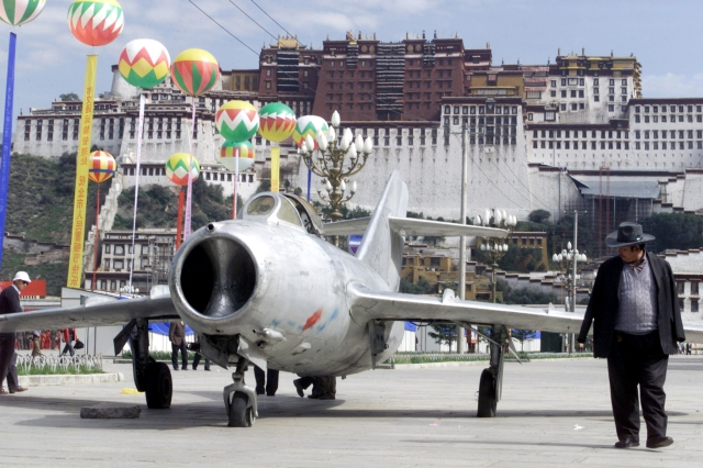 A 1950s Chinese fighter jet displayed at a square in front of Potala Palace in Lhasa - a seemingly symbolic representation of the presence of Chinese military.