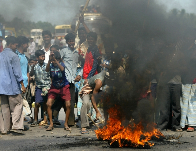 15 March 2007: Protesters set fire as they block a highway near Nandigram.