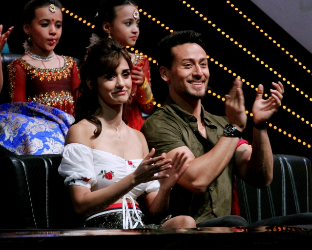 Tiger Shroff and Disha Patani watch the young contestants perform.