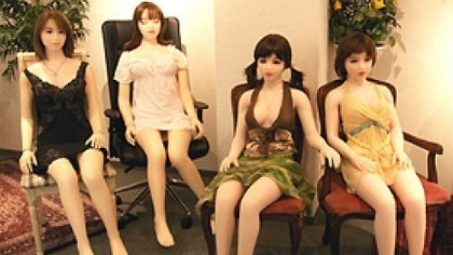 Sex or love dolls at display at an unknown location.