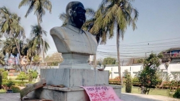 The statue of the Bharatiya Jana Sangh's founder was blackened and a poster left near it.