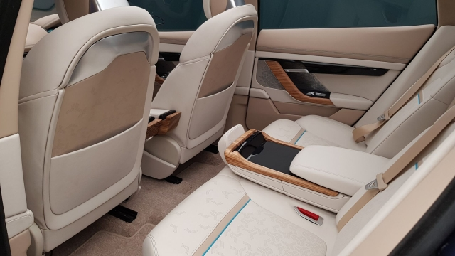 Rear seat legroom is good, thanks to a full flat floor under which the batteries are stored.